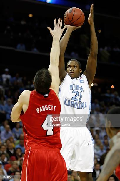 Deon Thompson of the North Carolina Tar Heels shoots over the arm of David Padgett of the Louisville Cardinals during the 2008 NCAA Men's East...