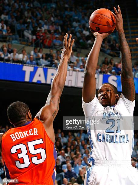 Deon Thompson of the North Carolina Tar Heels shoots over Trevor Booker of the Clemson Tigers during the game on January 21 2009 at the Dean E Smith...