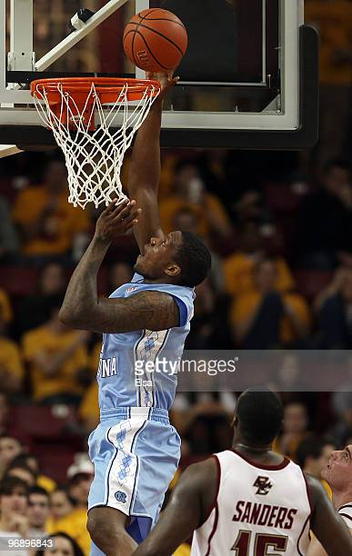 Deon Thompson of the North Carolina Tar Heels takes a shot as Rakim Sanders of the Boston College Eagles defends on February 20 2010 at Conte Forum...