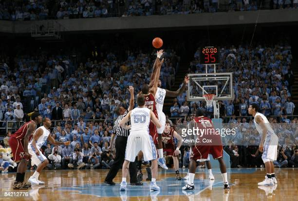 Deon Thompson of the North Carolina Tar Heels takes the opening game tip-off against Josh Southern of the Boston College Eagles during their game on...