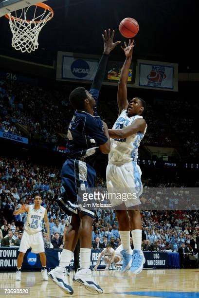 Deon Thompson of the University of North Carolina Tar Heels goes to the hoop against Roy Hibbert of the Georgetown Hoyas during the NCAA Men's East...