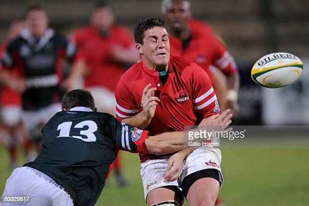 Deon van Rensburg tackles Dewald Pretorius during the Absa Currie Cup Promotion and Relegation match between Valke and Platinum Leopards held at...