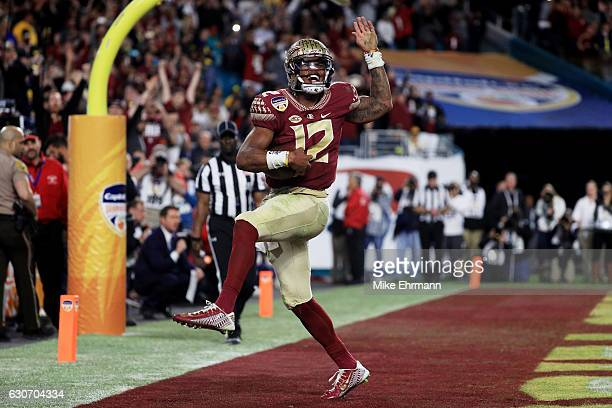 Deondre Francois of the Florida State Seminoles celebrates scoring a touchdown in the fourth quarteragainst the Michigan Wolverines during the...