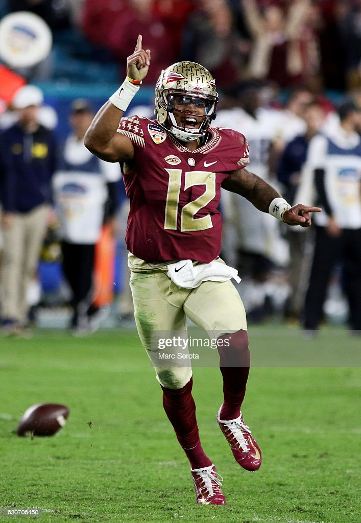 Deondre Francois #12 of the Florida State Seminoles celebrates their 33 to 32 win over the Michigan Wolverines during the Capitol One Orange Bowl at Sun Life Stadium on December 30, 2016 in Miami Gardens, Florida.