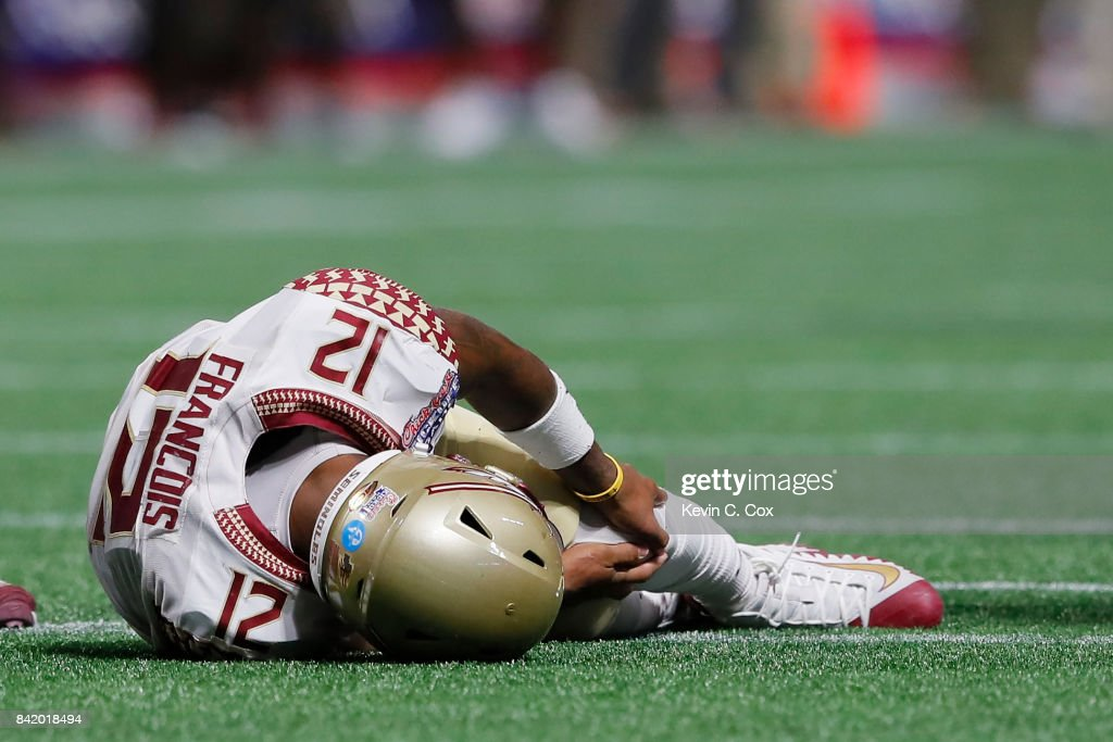 Deondre Francois #12 of the Florida State Seminoles hold his left leg after being injured in the fourth quarter of their game against the Alabama Crimson Tide at Mercedes-Benz Stadium on September 2, 2017 in Atlanta, Georgia.