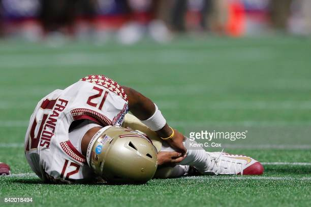 Deondre Francois of the Florida State Seminoles hold his left leg after being injured in the fourth quarter of their game against the Alabama Crimson...