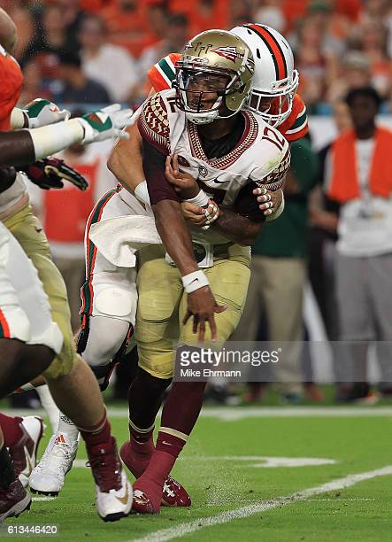 Deondre Francois of the Florida State Seminoles is injured after a pass during a game against the Miami Hurricanes at Hard Rock Stadium on October 8,...