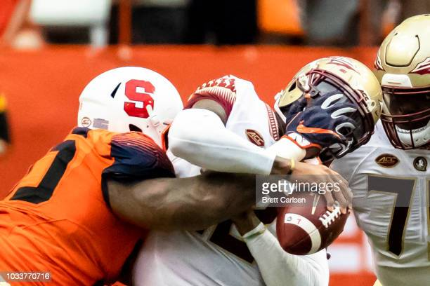 Deondre Francois of the Florida State Seminoles is sacked by Chris Slayton of the Syracuse Orange during the second half at the Carrier Dome on...