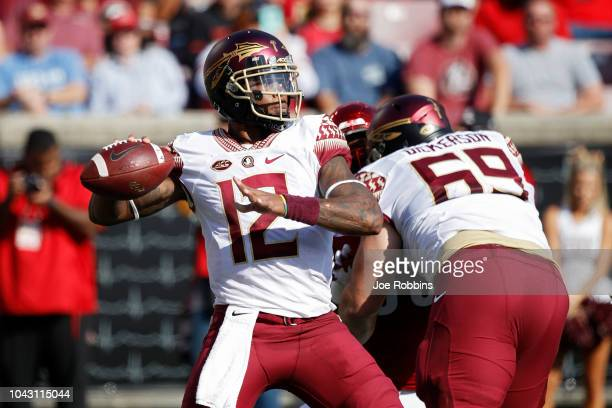 Deondre Francois of the Florida State Seminoles throws a pass against the Louisville Cardinals in the second quarter of the game at Cardinal Stadium...