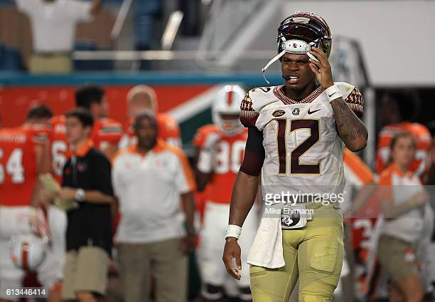 Deondre Francois of the Florida State Seminoles walks off the field after being injured during a game against the Miami Hurricanes at Hard Rock...