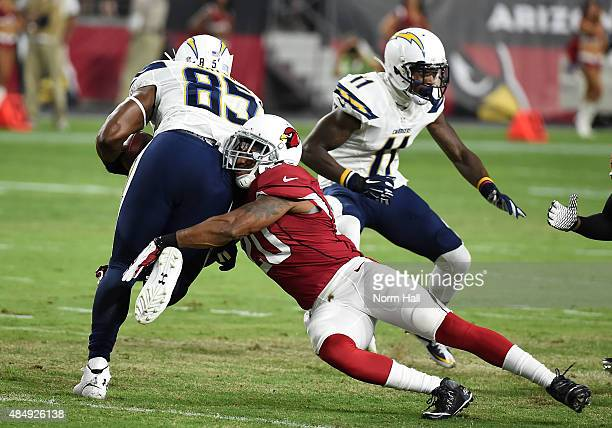 Deone Bucannon of the Arizona Cardinals makes a tackle on Antonio Gates of the San Diego Chargers at University of Phoenix Stadium on August 22 2015...