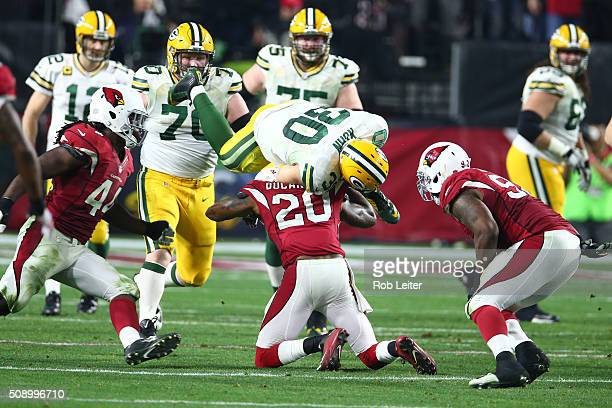 Deone Bucannon of the Arizona Cardinals tackles John Kuhn during the game against the Green Bay Packers at University of Phoenix Stadium on January...