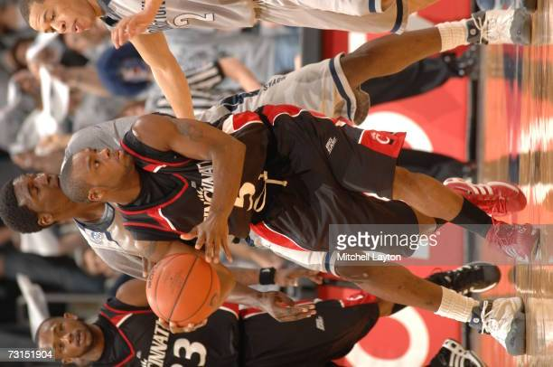 Deonta Vaughn of the Cincinnati Bearcats looks to pass during a college basketball game against the Georgetwon Hoyas at Verizon Center on January 27,...