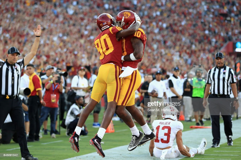 Deontay Burnett #80 of the USC Trojans celebrates with Jalen Greene #10 after scoring a second quarter touchdown against the Stanford Cardinal at Los Angeles Memorial Coliseum on September 9, 2017 in Los Angeles, California.