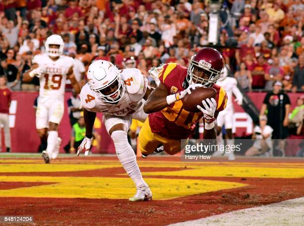 Deontay Burnett of the USC Trojans makes a catch for a touchdown in front of DeShon Elliott of the Texas Longhorns to take a 70 lead during the...