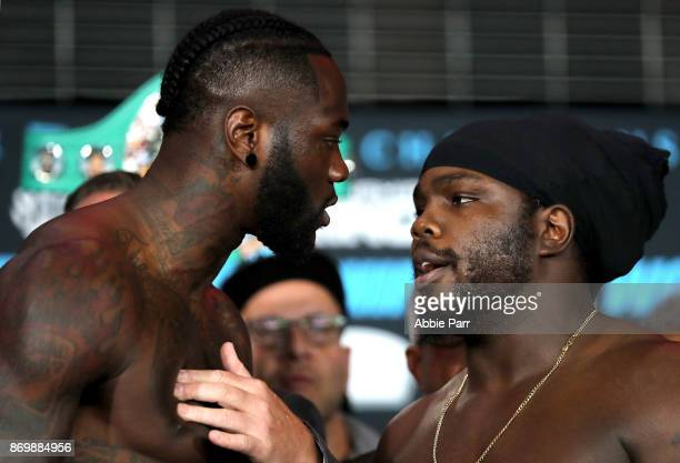 Deontay Wilder and Bermane Stiverne stare each other down during the official weigh in for their Heavyweight Championship of the World fight at...