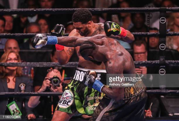 Deontay Wilder and Dominic Breazeale fight during their bout for Wilder's WBC heavyweight championship at Barclays Center on May 18 2019 in New York...