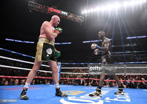 Deontay Wilder and Tyson Fury face each other in the ninth round fighting to a draw during the WBC Heavyweight Championship at Staples Center on...