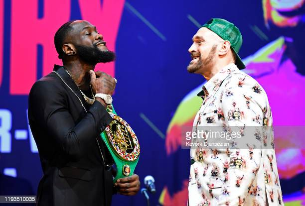 Deontay Wilder and Tyson Fury get together during a news conference at The Novo Theater at LA Live on January 13 2020 in Los Angeles California