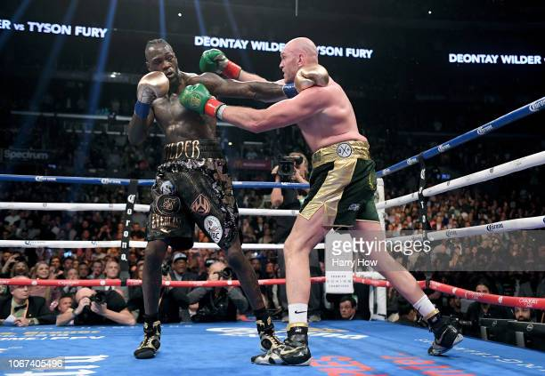Deontay Wilder and Tyson Fury punch each other in the ninth round fighting to a draw during the WBC Heavyweight Championship at Staples Center on...