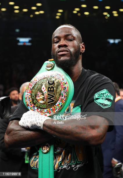 Deontay Wilder celebrates after knocking out Dominic Breazeale in the first round during their bout for Wilder's WBC heavyweight title at Barclays...