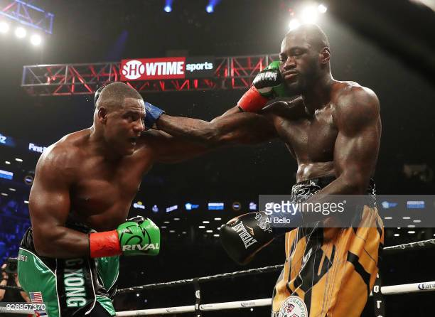 Deontay Wilder exchanges punches with Luis Ortiz during their WBC Heavyweight Championship fight at Barclays Center on March 3 2018 in the Brooklyn...
