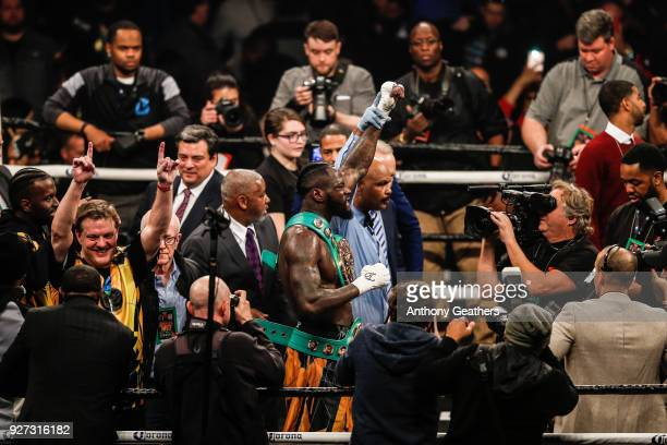 Deontay Wilder gets his hand raised by the referee after defeating Luis Ortiz by knock out in the tenth round during their WBC Heavyweight...