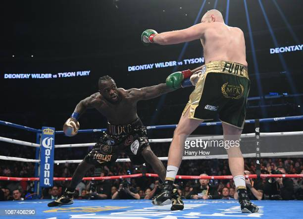 Deontay Wilder jabs Tyson Fury in the first round fighting to a draw during the WBC Heavyweight Championship at Staples Center on December 1 2018 in...