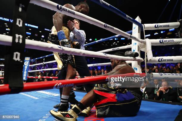 Deontay Wilder knocks down Bermane Stiverne in the first round during their rematch for Wilder's WBC heavyweight title at the Barclays Center on...