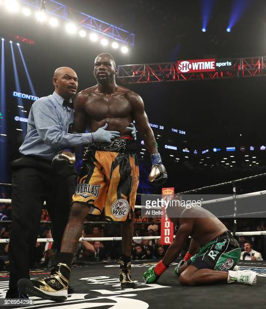 Deontay Wilder knocks down Luis Ortiz in the tenth round during their WBC Heavyweight Championship fight at Barclays Center on March 3 2018 in the...
