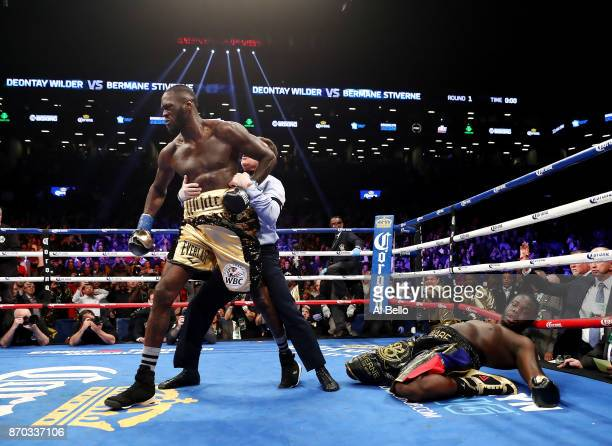 Deontay Wilder knocks out Bermane Stiverne in the first round during their rematch for Wilder's WBC heavyweight title at the Barclays Center on...
