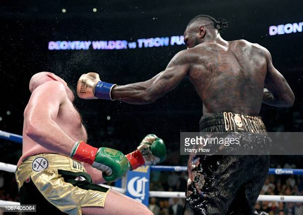 Deontay Wilder knocks Tyson Fury down during the 12th round resulting in a draw during the WBC Heavyweight Championship at Staples Center on December...