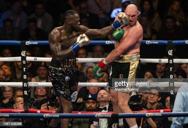 Deontay Wilder lands a left hand against Tyson Fury during the Showtime WBC Heavyweight Championship at the Staples Center in Los Angeles California...