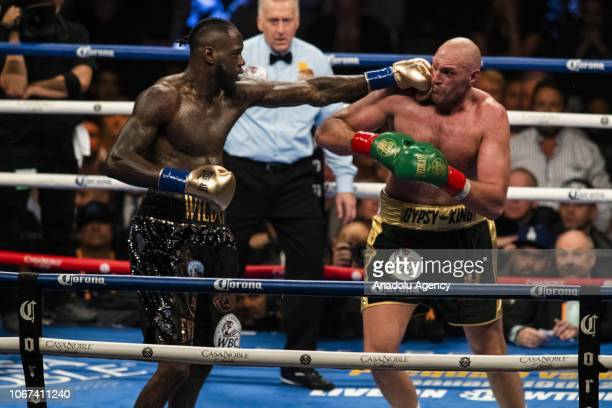 Deontay Wilder lands a left hand against Tyson Fury during WBC Heavyweight Championship at the Staples Center in Los Angeles California on December...