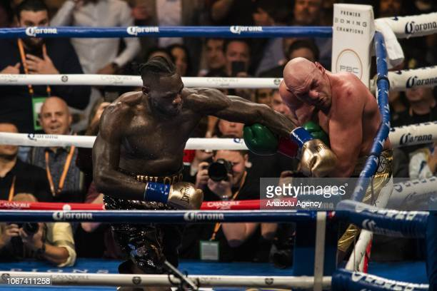 Deontay Wilder lands a left hand against Tyson Fury in the 12th round of WBC Heavyweight Championship at the Staples Center in Los Angeles California...