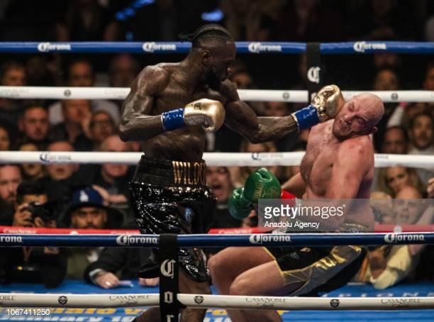 Deontay Wilder lands a left hook and knocks down Tyson Fury in the 12th round of WBC Heavyweight Championship at the Staples Center in Los Angeles,...