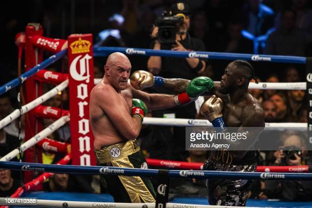 Deontay Wilder lands a right hand against Tyson Fury during WBC Heavyweight Championship at the Staples Center in Los Angeles California on December...