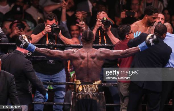 Deontay Wilder looks at the crowd and celebrates after knocking out Dominic Breazeale in the first round during their bout for Wilder's WBC...