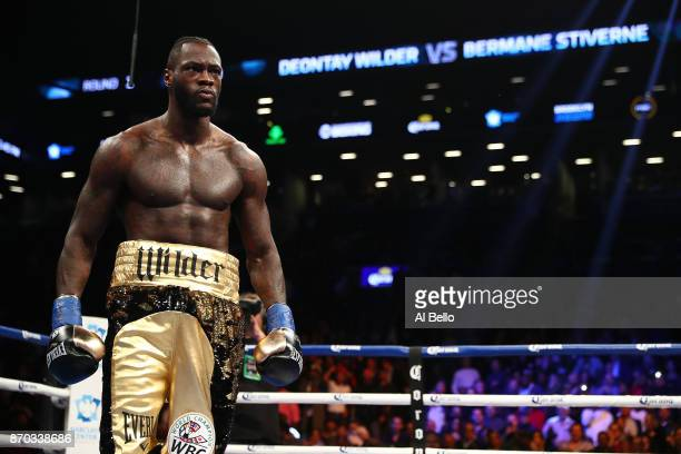 Deontay Wilder looks on after knocking down Bermane Stiverne in the first round during their rematch for Wilder's WBC heavyweight title at the...