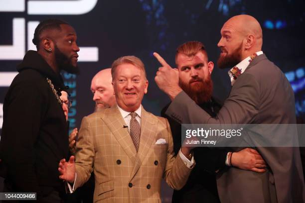 Deontay Wilder of United States and Tyson Fury of England reacts during a face off during a press conference ahead of the match between Tyson Fury...