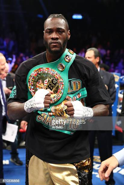 Deontay Wilder poses after knocking out Bermane Stiverne in the first round during their rematch for Wilder's WBC heavyweight title at the Barclays...