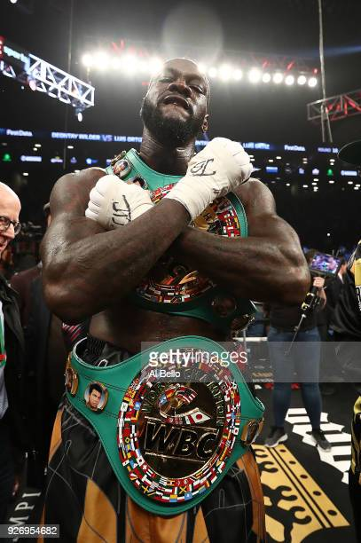 Deontay Wilder poses after knocking out Luis Ortiz in the tenth round of their WBC Heavyweight Championship fight at Barclays Center on March 3 2018...