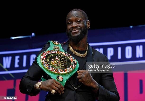 Deontay Wilder poses with the belt during a news conference with Tyson Fury at The Novo Theater at L.A. Live on January 13, 2020 in Los Angeles,...