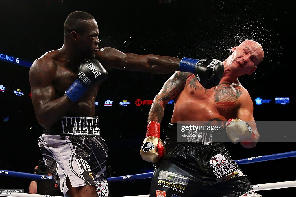 Deontay Wilder punches Artur Szpilka during their WBC Heavyweight Championship bout at Barclays Center on January 16, 2016 in Brooklyn borough of New York City.