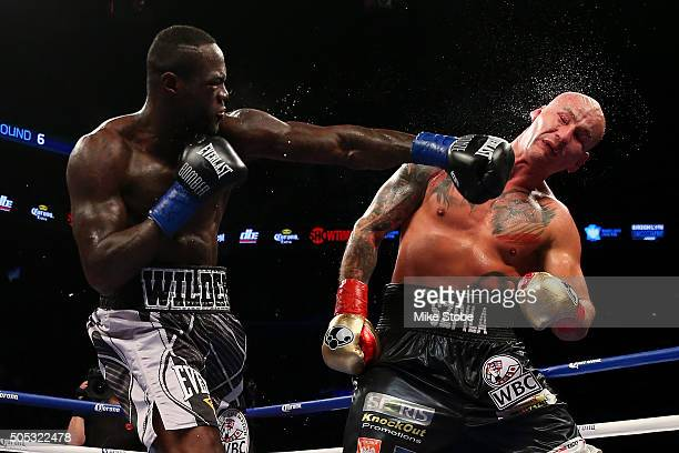 Deontay Wilder punches Artur Szpilka during their WBC Heavyweight Championship bout at Barclays Center on January 16 2016 in Brooklyn borough of New...