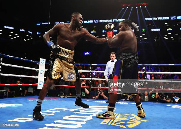 Deontay Wilder punches Bermane Stiverne during their rematch for Wilder's WBC heavyweight title at the Barclays Center on November 4 2017 in the...