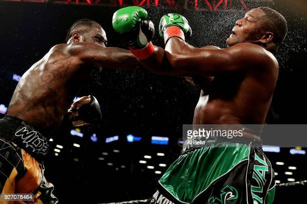 Deontay Wilder punches Luis Ortiz during their WBC Heavyweight Championship fight at Barclays Center on March 3 2018 in the Brooklyn Borough of New...