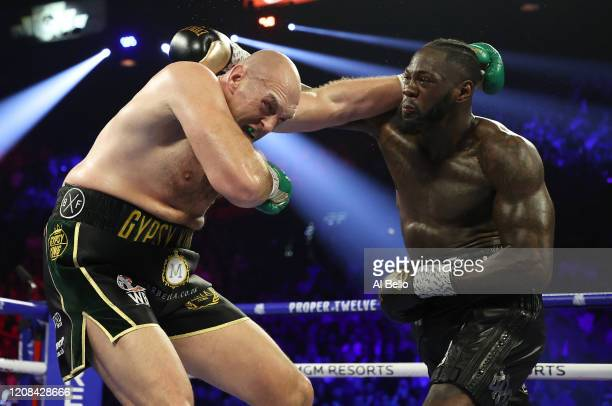 Deontay Wilder punches Tyson Fury during their Heavyweight bout for Wilder's WBC and Fury's lineal heavyweight title on February 22 2020 at MGM Grand...