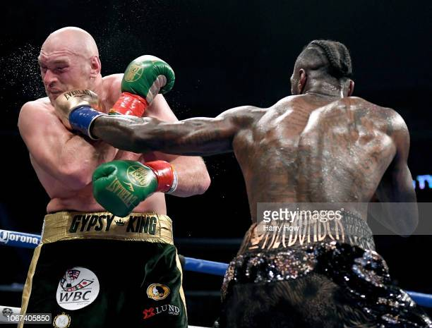 Deontay Wilder punches Tyson Fury in the fifth round fighting to a draw during the WBC Heavyweight Championship at Staples Center on December 1 2018...
