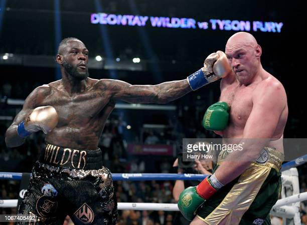 Deontay Wilder punches Tyson Fury in the ninth round fighting to a draw during the WBC Heavyweight Championship at Staples Center on December 1 2018...